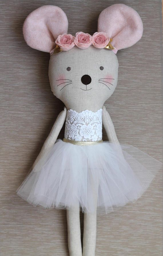 Pink & Gold mouse ballerina stuffed animal in a white tutu.  Darling!  It's available on etsy (affiliate link).