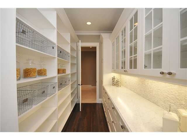 Butler's pantry. Cabinets on one side with counter. Open shelves on the other.