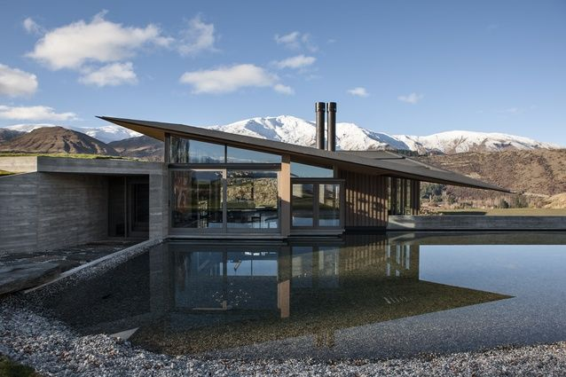 The palette of this home includes polished and board-formed concrete, stone, glass and water.