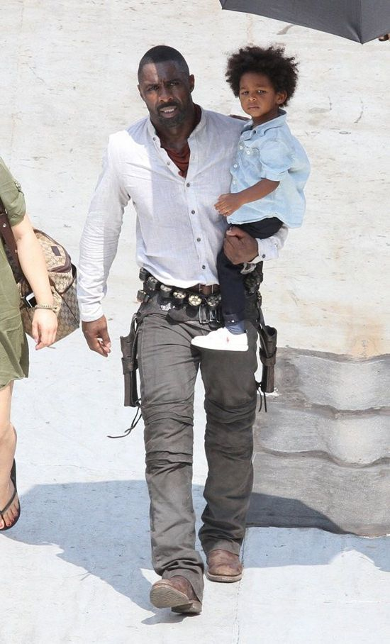 "Idris Elba on the set of ""The Dark Tower"" visited by his young son, Winston. -- egg drop"