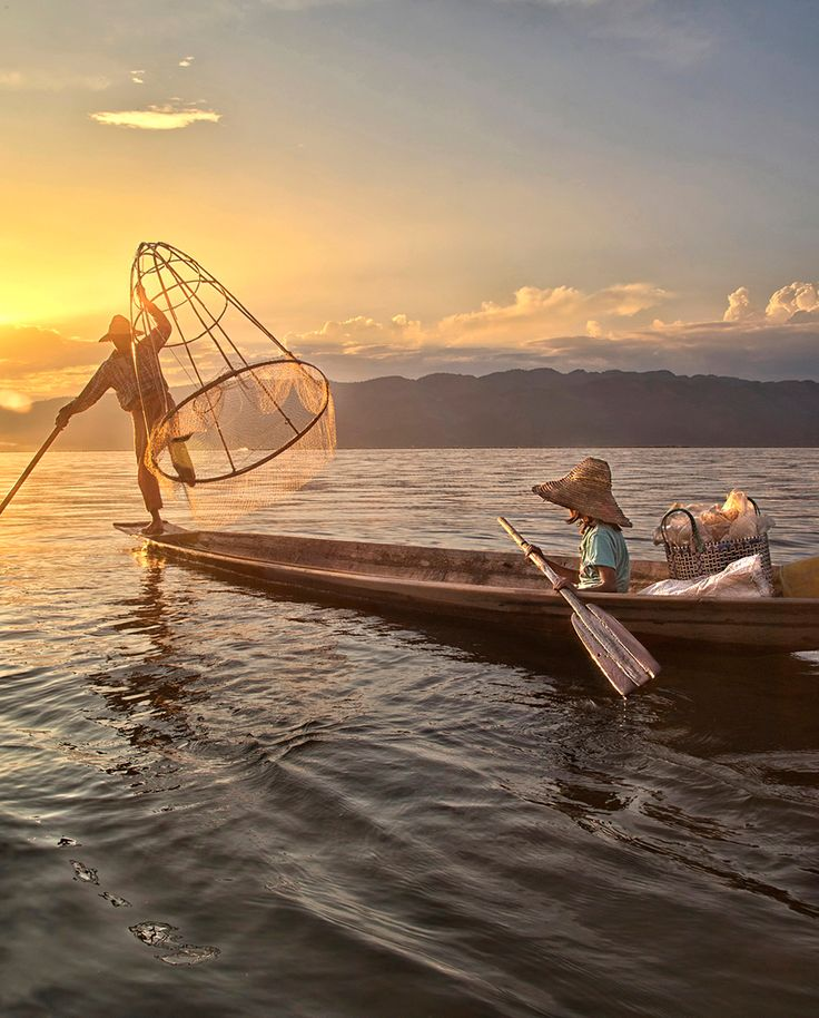 Fishing - A father and daughter with a fish in the net at sunset on Inle Lake, Myanmar. Inle Lake, Myanmar. (Cynthia MacDonald/National Geographic Traveler Photo Contest)