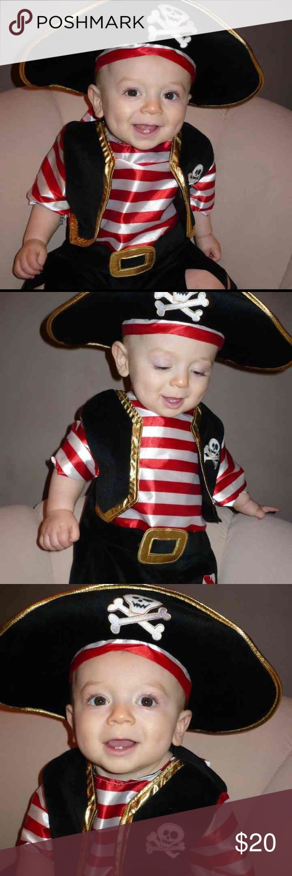 Pirate Halloween Costume 6-9 months New with tags  Size 6-9 months  Deluxe baby pirate Halloween costume  Amazing quality - high end materials/fabrics  We purchased two different sizes for fit. One piece that zips up the back.  Shirt, vest, pants and belt all attached.  Hat included. Costumes Halloween