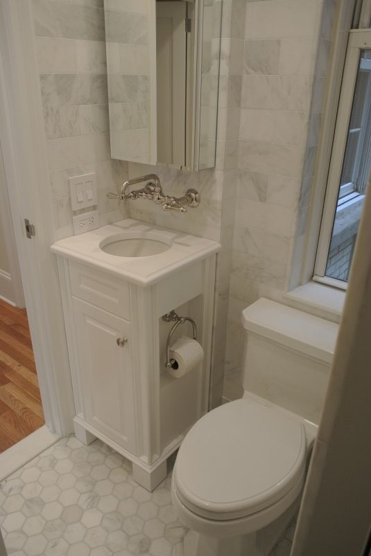 a small space bath gets a sophisticated makeover the custom white corner vanity - Bathroom Cabinets Small Spaces