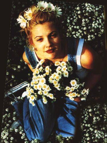 Drew in her overalls, wearing dark lippy and a million daisies!