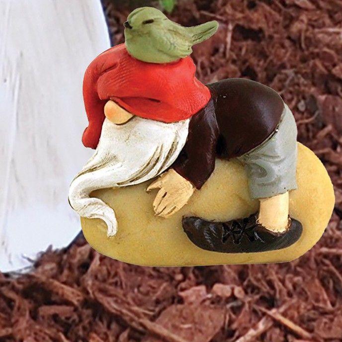 Napping garden gnome on stone