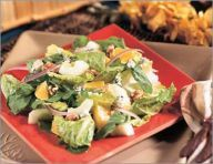 Orange-walnut salad-  Layer the ingredients in a large salad bowl, then add the dressing and cheese just before serving.