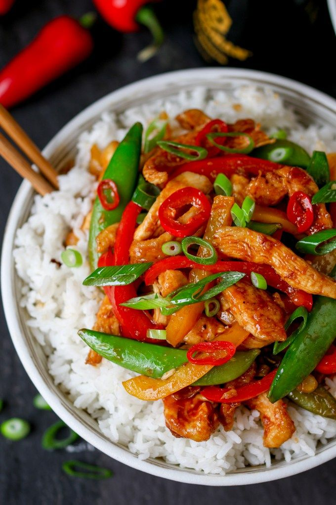 Easy Chicken and veggie stir fry - a quick mid-week meal with a kick of chilli heat that you can get on the table in less than 20 minutes!