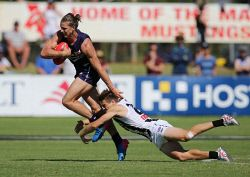SUN-1401102 © WestPix AFL. The Fremantle Dockers are taking on Collingwood at Rushton Park in Mandurah. Pictured - Docker Nat Fyfe tries to evade Collingwoods Josh Thomas. Picture - Justin Benson-Cooper The Sunday Times
