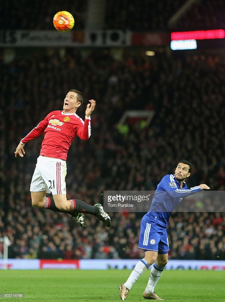 Ander Herrera of Manchester United in action with Pedro during the Barclays Premier League match between Manchester United and Chelsea at Old Trafford on December 28, 2015 in Manchester, England.