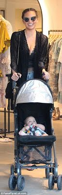 Welcome to Oghenemaga Otewu's Blog: Chrissy Teigen stylish as she takes baby Luna shop...