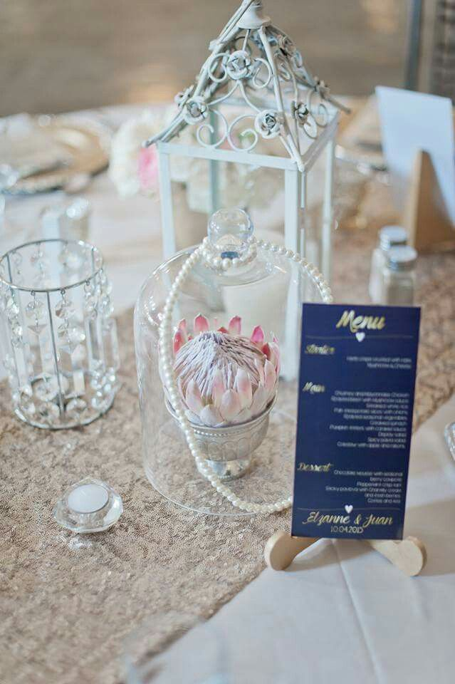 Elzanne and Juan wedding, proteas, clock vase, gold sequins, pearls, navy and gold. Proudly White Lace Events www.whitelaceevents.co.za