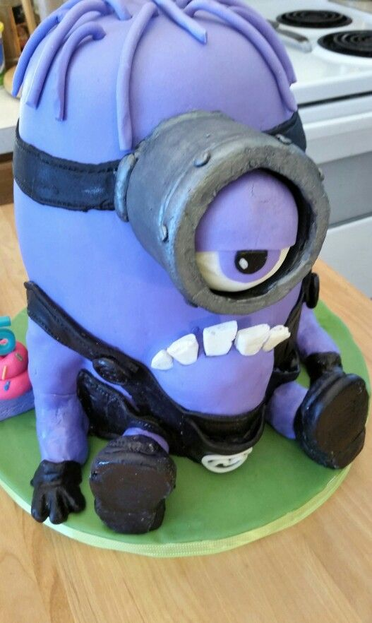 My creation. Minion cake (lemon cake layers with blueberry buttercream frosting, covered in marshmallow fondant).