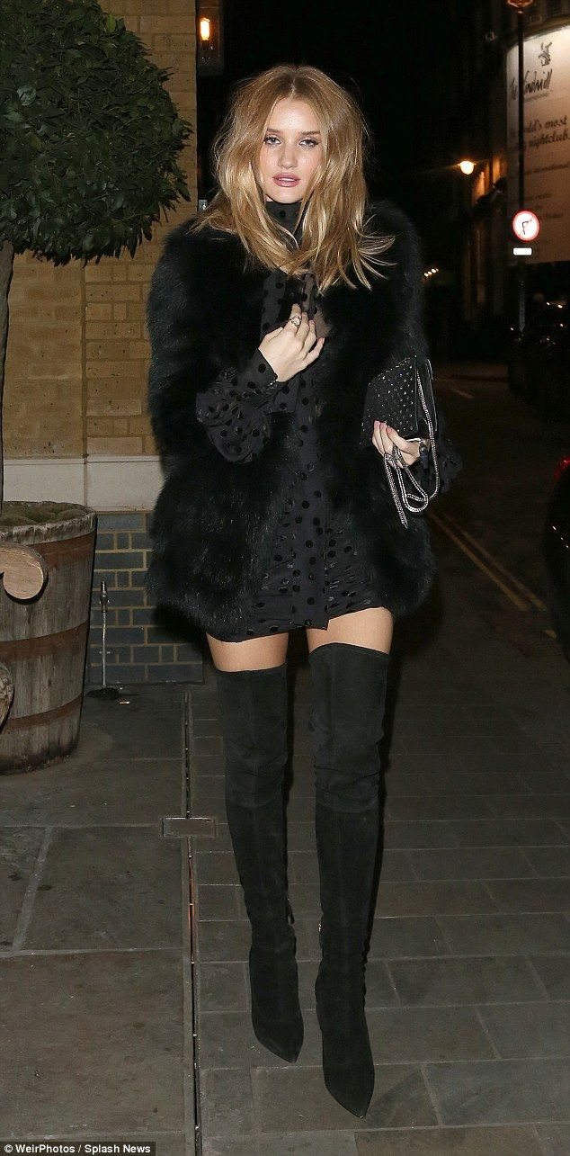 5d0e71a550d Rosie Huntington-Whiteley shows off long legs in thigh-high boots ...