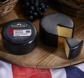 Westminster London Truckle - Powerful 12 month hold white #Cheddar #Truckle sealed in black wax. #EnglishCheese #EnglishCheddar #Australia #Cheese #lovecheese