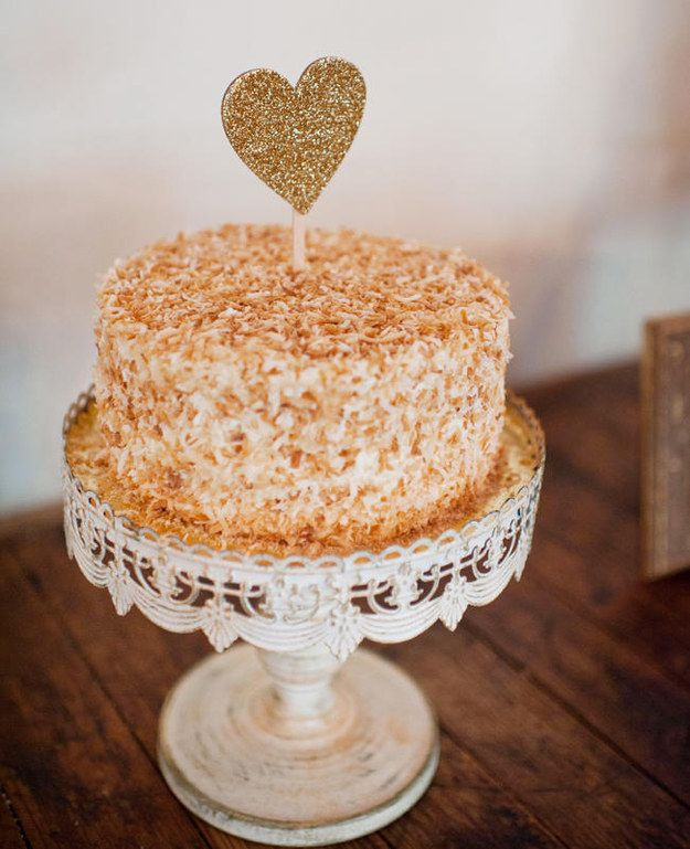 This toasted coconut-covered one with the sweetest topper ever. | 24 One-Tier Wedding Cakes That Prove That Less Is More