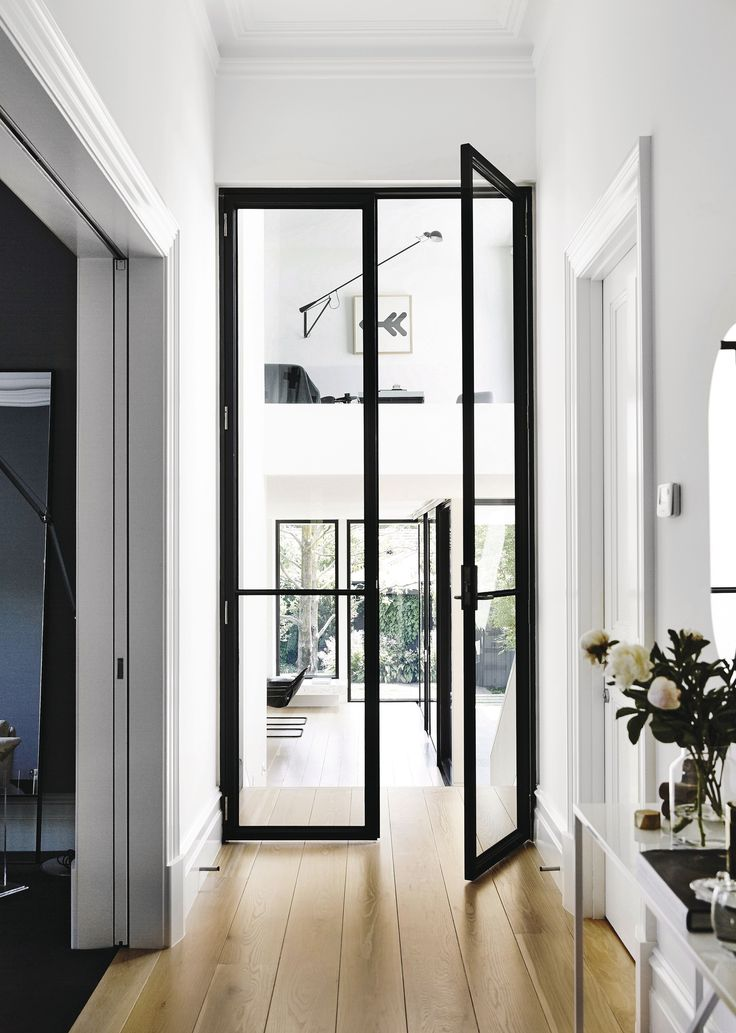 Light walls with black metal doors, etc Official: This Is What the Ultimate Dream Home Looks Like in 2017 via @MyDomaine