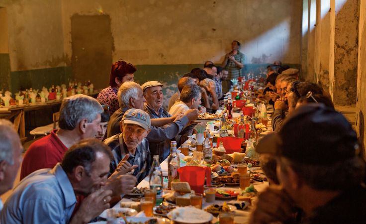 Supra (feast table) at 1-yr old birthday party in Svaneti, Georgia. Image from NATIONAL GEOGRAPHIC, October 2014.
