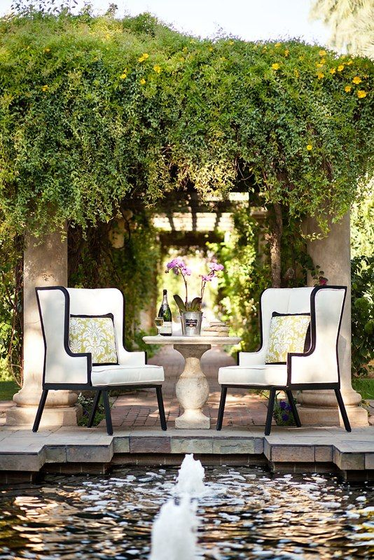 Chic Outdoor Living Space with Black and White Upholstered Chairs