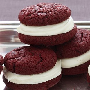 A delicious new way of serving Red Velvet cake -- as a fun sandwich cookie. Tastes great and makes for a playful addition to any dessert tray.