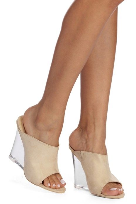 572b637e0de Get stuck on these natural lucite heels at first sight! They feature an  open back