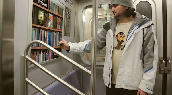 """""""The Subway Library"""" - the idea is brilliantly simple: posters with book titles and scannable barcodes are placed in subway cars where riders scan a book they are interested in (using Near Field Communication) and immediately get a ten-page preview. At the end of the preview, readers are prompted with the location of the closest library where the book is available."""