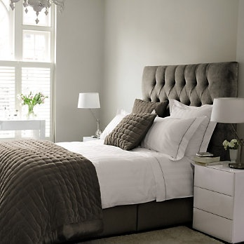 Gray is my thing lately. But the big winner here is the plush headboard - I want, I want!