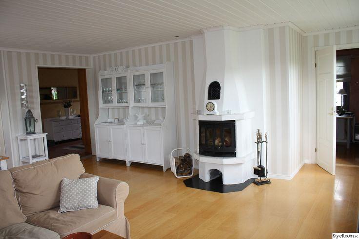 vitrinskåp,vitt,kamin,vardagsrum