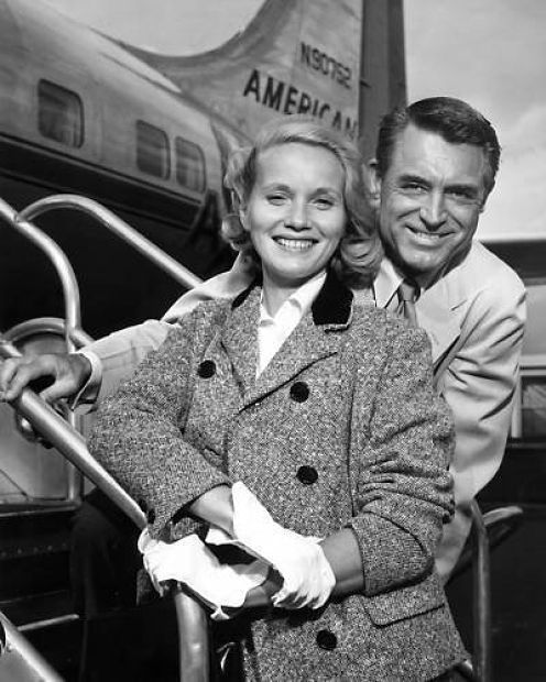 "Eva Marie Saint and Cary Grant board a plane bound for Chicago at La Guardia Airport to continue shooting ""North by Northwest"""
