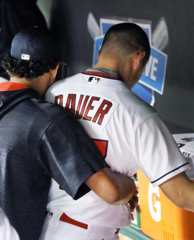 Cleveland Indians Danny Salazar gives a hug to Trevor  Bauer in the Indians dugout after Bauer pitched 8 and 2/3 innings against the Chicago White Sox at Progressive Field in Cleveland, Ohio on September 23, 2016.  The Indians were leading 10-4 over the Sox when Bauer was pulled.  (Chuck Crow/The Plain Dealer)