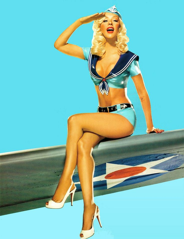 Christina Aguilera, Pin Up style on the military airplane wing. Traditional Pin