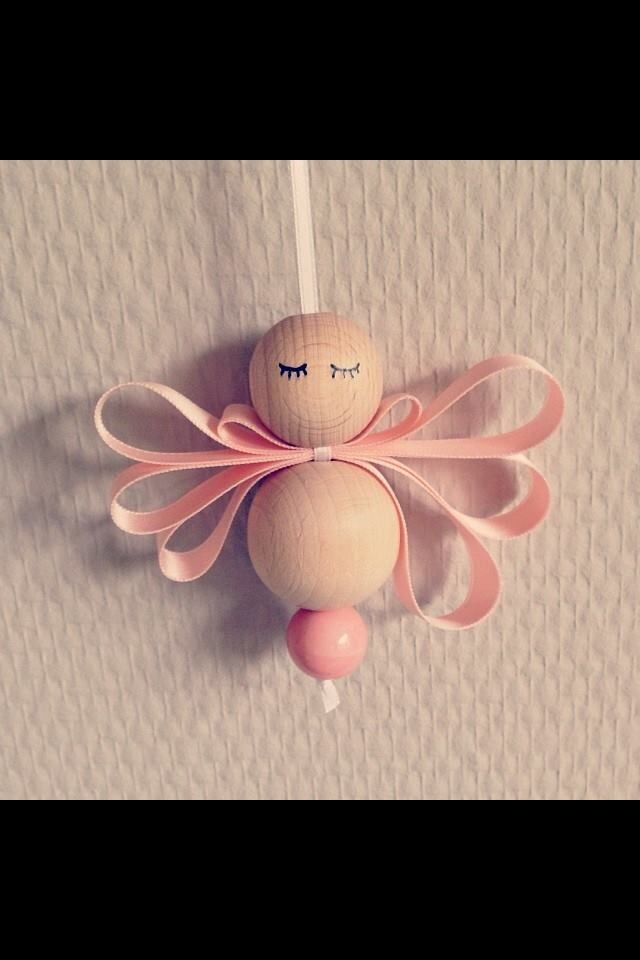 Wooden Bead Angel - could change it into a baby? bow round neck and cap?