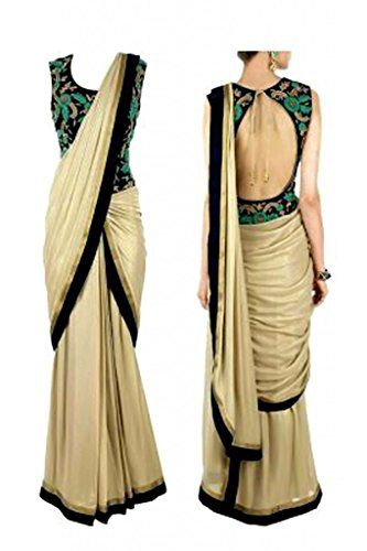 This Is a Bollywood Style Party Wear Saree. Saree In Beige Color with Black Border and designer Embroidred blouse look Gorgeous on you.