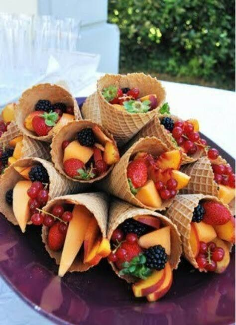 What a cute idea! Fresh fruit in waffle cones for individual servings.