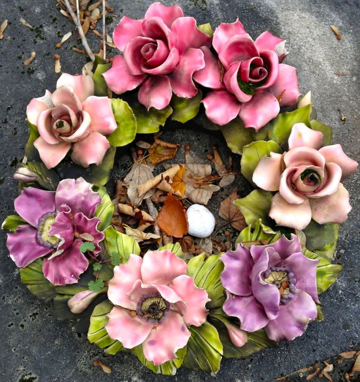 Majolica wreath contaning the Famous French Ceramic Flowers. Contact Keramiek voor buiten for more information on these Famous French Ceramic Flowers