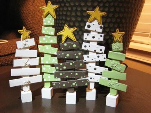 Popsicle Stick Christmas Trees; Trim off the round ends to make varying lengths of sticks and glue cross-wise on a full length stick. Paint in your desired colors and attach a star to the top of each tree. You can mount each one on a wooden block or shape a white piece of foam into a snowy landscape and press each tree into it.