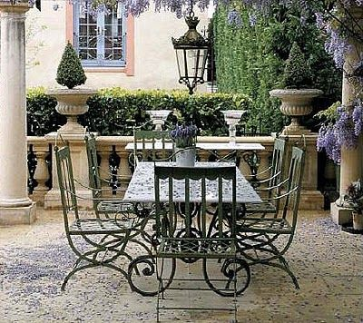 terrace: love the iron table/chairs and the lantern, wisteria