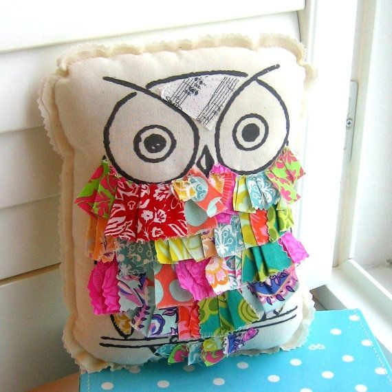Use fabric paint to draw the eyes, nose and perch. Then start sewing on the scraps – I'd suggest starting at the bottom and work your way up to the eyes. Great way to use up all those f…