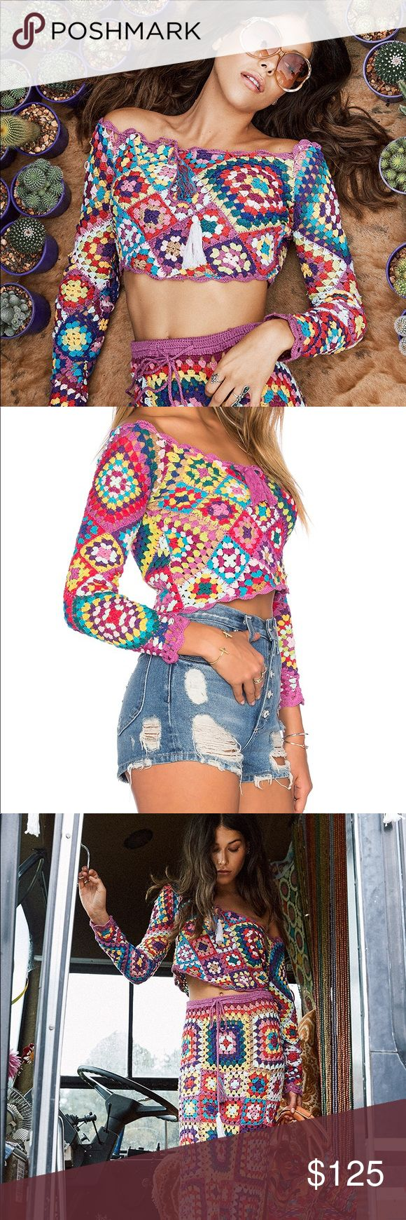 spell & the gypsy carnaby crochet crop top WILL SELL CHEAPER ON OTHER APPS. PRICE REFLECTS POSH FEES. worn once spell designs carnaby crochet crop top. rare item, super cute, flattering, off the shoulder granny square crochet style. tag says size M/L, but i think it can fit smaller or larger body types- i wear XS in most clothes and it fits me fine. (3rd pic is me wearing it) it has one small hole on right arm, price reflects this. this is my FAVOURITE top in my closet but i don't get to…