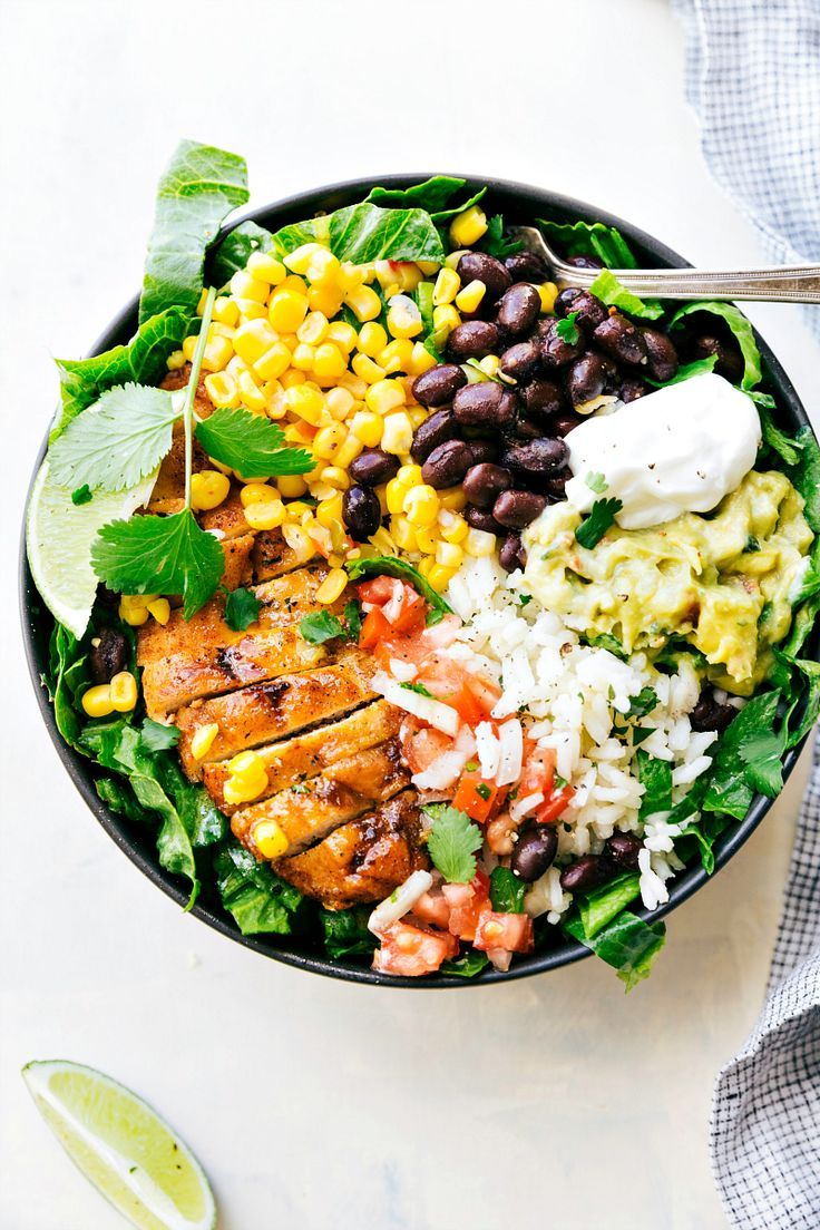 EASY MEAL PREP Chicken Burrito Bowls!! Tons of short-cuts for a better than a restaurant burrito bowl! Taco-seasoned chicken, cilantro-lime rice, salsa, guac, beans, and a creamy cilantro sauce! via http://chelseasmessyapron.com