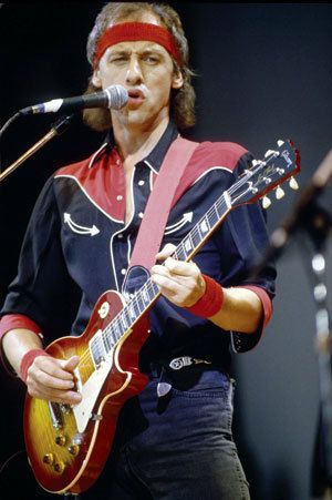 Mark Knopfler performs with Dire Straits.  His solo stuff was great as well.