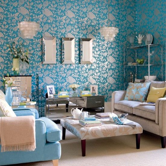 The wallpaper in a dramatic damask print in this room gives a feeling of grandeur. The print is repeated on furnishings around the room. The look is completed with large mirrors and mother of pearl lamps.