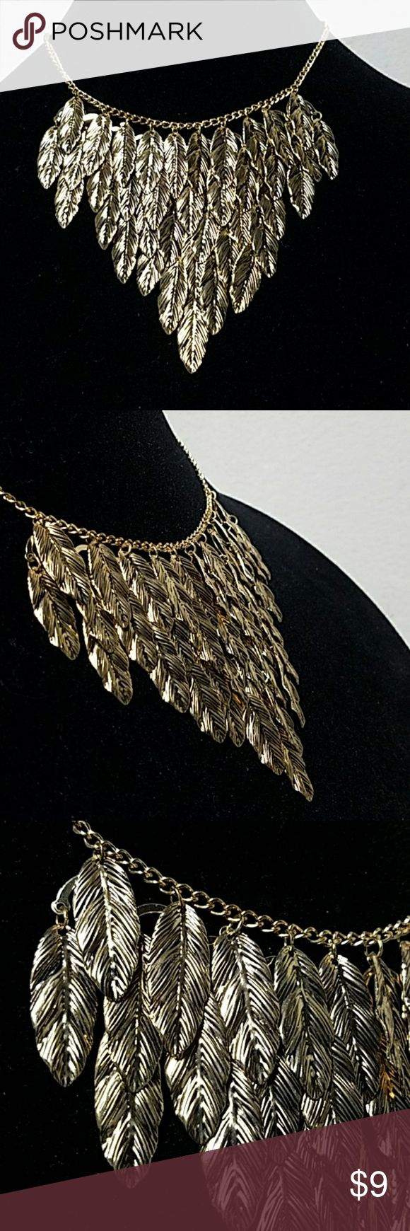 """Antiqued Gild Feather Cluster Collar/Choker 14"""" Gold Chain w/Lobster Closure. 3 inches of (1"""") Antiqued Gold Feathers Form This Bib Style Necklace. Item#N958 *ALL JEWELRY IS NWT/NWOT/UNUSED VINTAGE* 25% OFF BUNDLES OF 3 OR MORE ITEMS! ALL REASONABLE OFFERS ACCEPTED!BUY WITH CONFIDENCE TOP 10% SELLER, FAST SHIPPING, 5 STAR RATING, FREE GIFT w/ MOST ORDERS! Jesi's Fashionz  Jewelry Necklaces"""