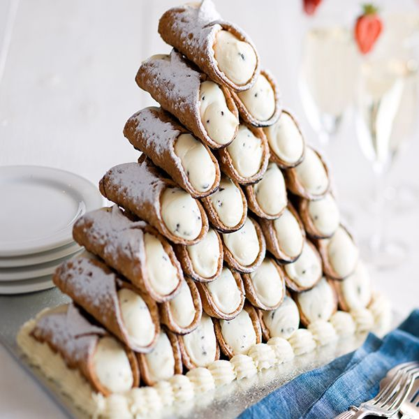Cannoli Tower What could be more delightful than a fried, crunchy pastry shell filled with your choice of fresh Italian custard or ricotta cream, then lightly sprinkled with icing sugar? Grab several dozen of these classic Italian pastries and stack them in pretty towers on your dessert table for a sophisticated wedding cake alternative. Photo via Crinti's Restaurant .