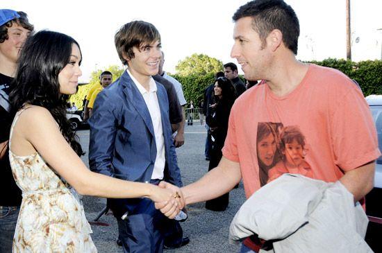 Adam Sandler extends a hand to Vanessa Hudgens as Zac Efton looks on at the 2008 MTV Movie Awards. | MTV Photo Gallery