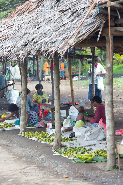 Roadside market where people are selling vegetables and betel nut, near Lae, Papua New Guinea