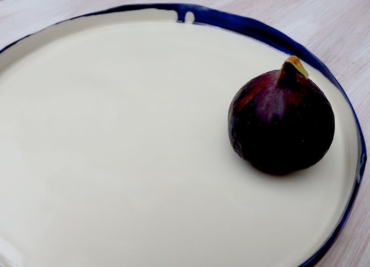 porcelain platter form with uneven edges; handmade and crafted in London, UK