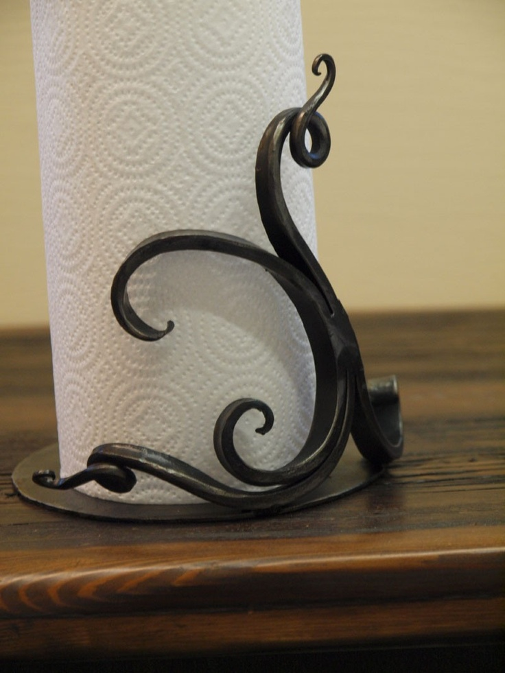 Countertop paper towel holder - hand forged by a blacksmith. $120.00, via Etsy.