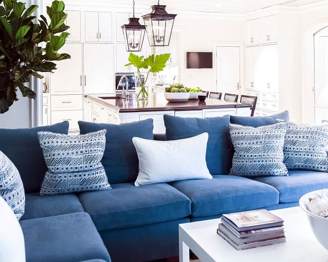 Family room with Navy Blue Sectional with blue and white pillows. J.K. Kling Associates Interior Design.