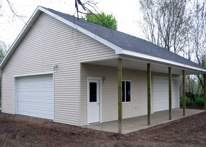 Pole barn garage with porch garage and workshop for Pole barn shop plans