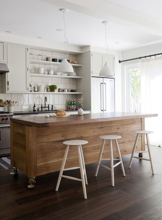 SIMO Design put this large kitchen island on wheels into one of its projects and we are taken with the concept. And the execution. It's from their Flower Loft in...